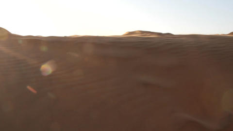 The wind blows thin sand from the crest of the dune Footage