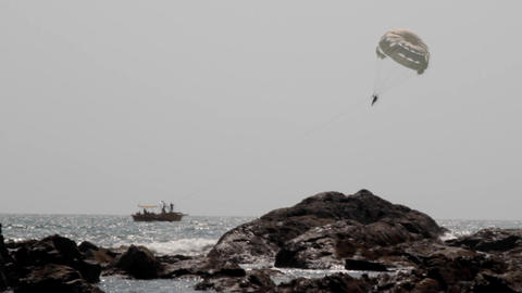 Parasailing is an active form of recreation in Arabian sea Live Action