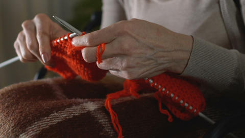 Female shaking hands trying knit, concentrating hobby, parkinson disease symptom Live Action