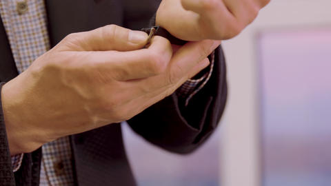 Man closing watch button on wrist hand closeup. Man style, fashion and accessory Footage