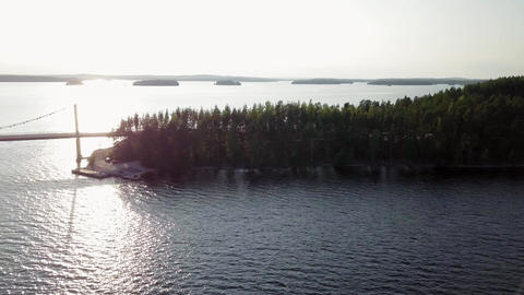 Bridge connecting ridge in middle of lake Footage