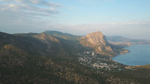 Aerial shot of amazing mountains and rocks on a seashore. Karaul-oba Mountain in Live Action