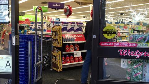 Missouri City, Texas - April 23 2016 man walks into a walgreens store Footage