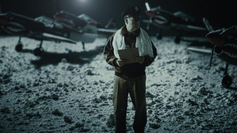 WWII Air Corps Officer Taking Notes In The Snow stock footage