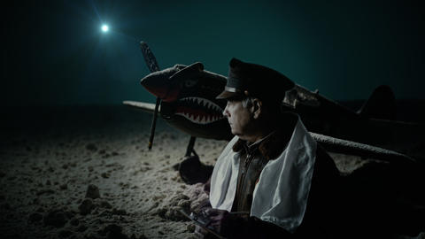 tilt to WWII Army Air Corps officer taking notes at night Footage