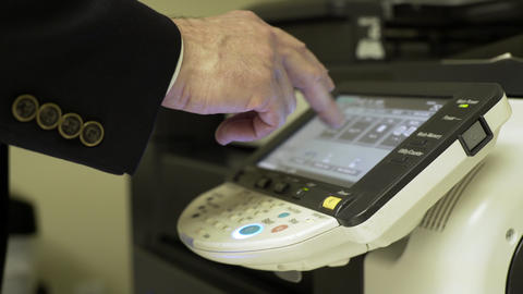 businessman pressing the touch screen if a large copier 4k Footage