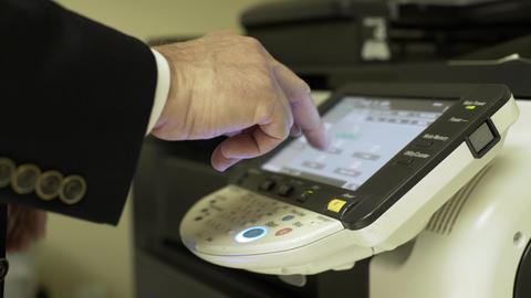 businessman at a large copier making copies 4k Live Action