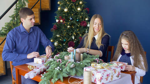 Family preparing christmas gifts in domestic room Footage