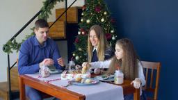 Joyful family eating christmas cookies at xmas eve Footage