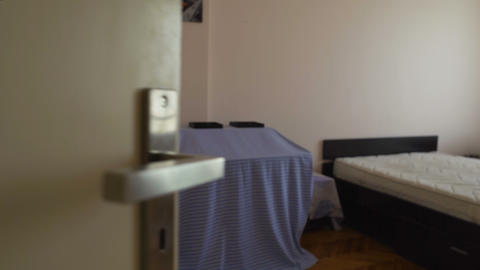 Small modestly furnished rented room in hostel, cheap accommodation, motel Footage