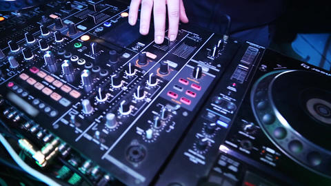 DJ playing on the best, Dj mixes the track in the nightclub at party Footage