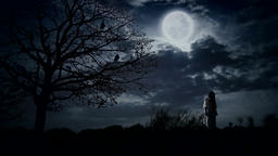 Scary girl under full moon next to the tree with ravens GIF