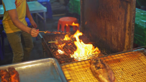 Chef cook chicken saute on grill at food market GIF