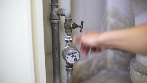 Builder opening water tap to see work of new pipes and correct work of meter Footage