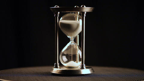 Hourglass. Clock. Glass Live Action