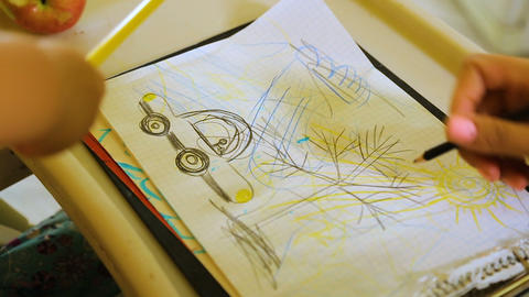 Little kid drawing picture with pencils, rejecting mothers help, creative hobby Footage