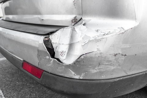 Back of gray car get damaged from accident on the road Photo