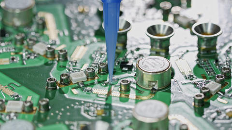 Close up of glue application on a large circuit board Live Action