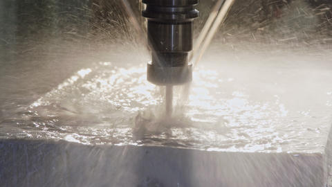 CNC mill manufacturing an advanced metal part with liquid cooling Footage