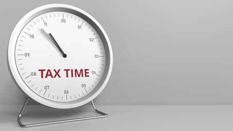 Clock with revealing TAX TIME caption. Conceptual animation Footage