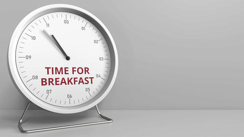Clock face with revealing TIME FOR BREAKFAST text. Conceptual animation Live Action