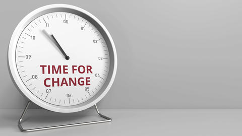 Clock face with revealing TIME FOR CHANGE text. Conceptual animation Live Action