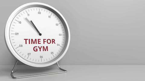 TIME FOR GYM caption on the clock face. Conceptual animation Footage