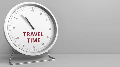 Clock face with revealing TRAVEL TIME text. Conceptual animation Footage