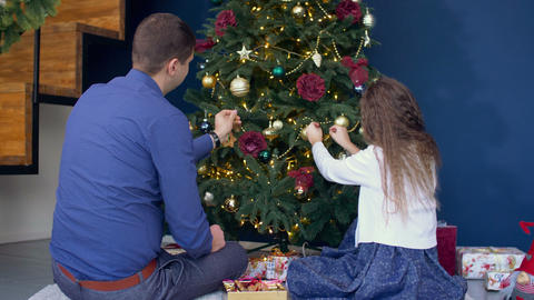 Happy family decorating Christmas tree at home Footage