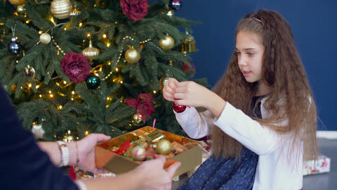 Little girl helping decorating the Christmas tree Footage
