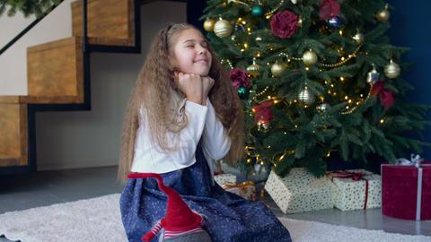 Joyful dreamy girl making a wish for christmas Footage