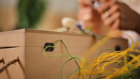 Lady gluing decorative flower on handmade wooden box, present preparation Footage