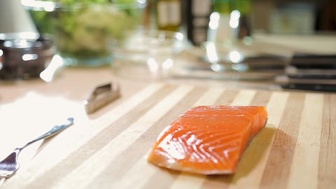 Japanese sushi chef carefully cutting salmon fish fillet, healthy seafood Archivo