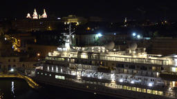 Malta Valletta move along old cruise liner at berth in harbor by night GIF