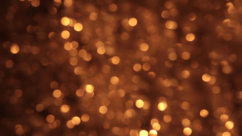 Gusty wind shakes bokeh from gold tinsel Footage