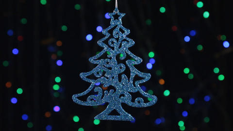 Christmas decorations, herringbone hanging on the background of flashing lights Footage