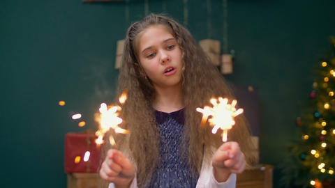 Cheerful little girl playing with sparklers at xmas Footage