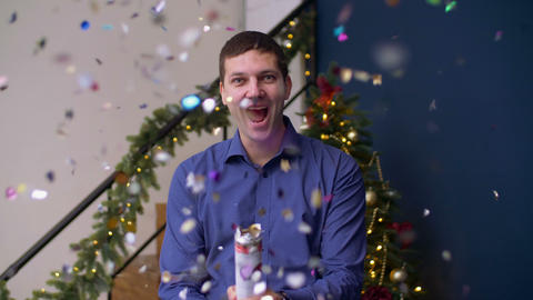 Ecstatic man exploding christmas confetti cracker Live Action