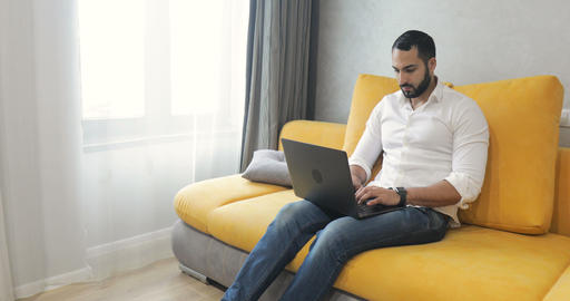 Man Uses Laptop in Living Room Footage