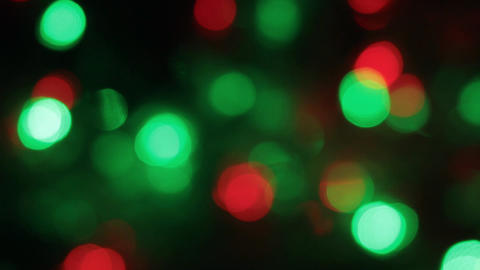 Rotation of the colorful and blinking Christmas bokeh. Abstract background with Footage