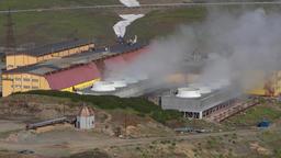 Smoking clouds of steam from pipes. Mutnovskaya Geothermal Power Plant ビデオ