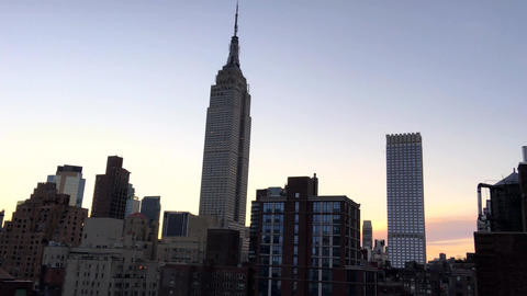 New York City – Manhattan skyline from rooftop at sunset Footage