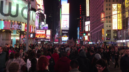 NEW YORK CITY - CIRCA OCTOBER, 2015: Tourists at night in Times Square. The city Footage