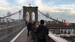 NEW YORK CITY - CIRCA OCTOBER, 2015: Tourists walking on Brooklyn Bridge. The ci Footage