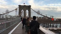 NEW YORK CITY - CIRCA OCTOBER, 2015: Tourists walking on Brooklyn Bridge. The ci Footage