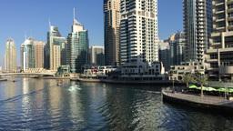DUBAI - NOVEMBER 22, 2015: Dubai Marina buildings. The city attracts 14 million  Footage