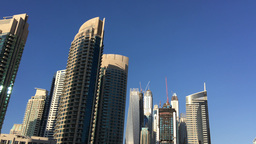 DUBAI - NOVEMBER 22, 2015: Dubai Marina buildings. The city attracts 14 million  Live Action