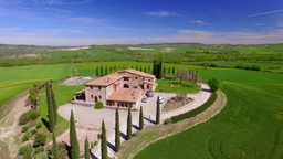TUSCANY – APRIL 2016: Agriturismo along spring hills. Tuscany is a favourite i Footage