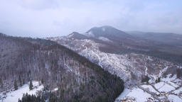 Aerial beautiful winter landscape with snow falling GIF