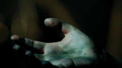 Dirty zombie hand, victim reaching out the murderer, asking for mercy, closeup Live Action